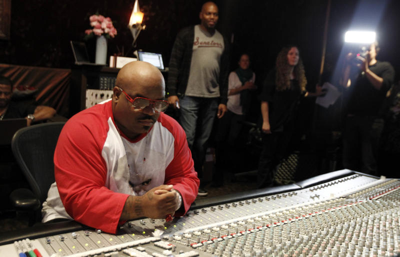 """In this May 2, 2012 photo, musician Cee-Lo Green is shown in a music studio in Los Angeles. Green, a judge on the singing competition series """"The Voice,"""" says he'll stick with the show """"as long as it's fresh."""" The rapper turned singer joined the show last year as coach and judge alongside Christina Aguilera, Blake Shelton and Adam Levine. (AP Photo/Matt Sayles)"""