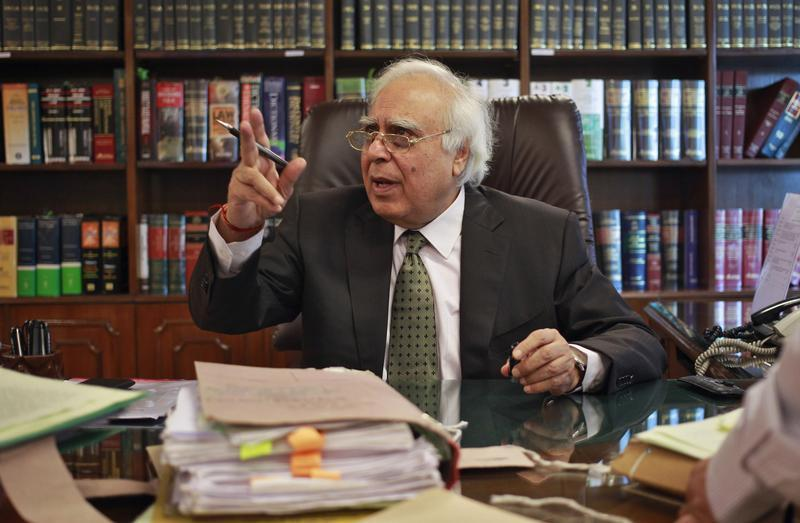India's Telecommunications Minister Sibal gestures after an interview with Reuters at his office in New Delhi