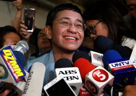 Maria Ressa, the CEO of online news platform Rappler, speaks to the media after posting bail at a Manila Regional Trial Court in Manila City, Philippines, February 14, 2019. REUTERS/Eloisa Lopez