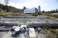 A new manufactured home is delivered to a property in Otis, Ore., on Thursday, May. 13, 2020. The small Oregon coast town is still recovering from the devastating fire that destroyed 293 homes.Experts say the 2020 wildfire season in Oregon was a taste of what lies ahead as climate change makes blazes more likely and more destructive even in wetter, cooler climates like the Pacific Northwest. (AP Photo/Craig Mitchelldyer)