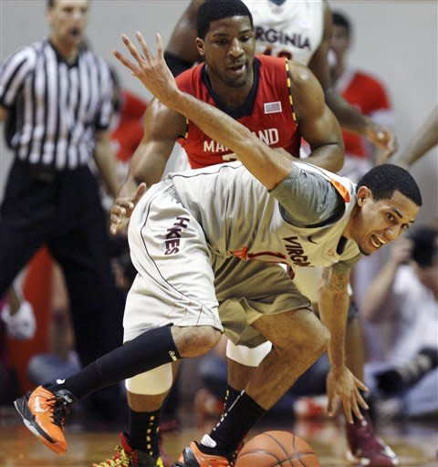 Virginia Tech's Erick Green (11) loses the ball while being guarded by Maryland's Pe'Shon Howard (21) during the first half of their NCAA college basketball game, Thursday, Feb. 7, 2013, in Blacksburg, Va. (AP Photo/The Roanoke Times, Matt Gentry)