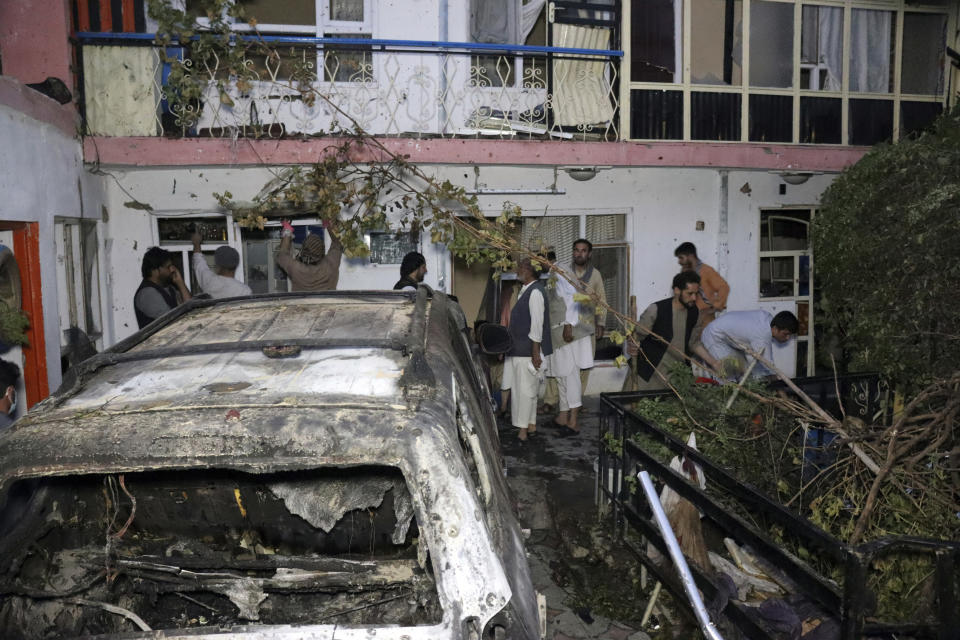 FILE - In this Sunday, Aug. 29, 2021 file photo, Afghans inspect damage of Ahmadi family house after U.S. drone strike in Kabul, Afghanistan. The Pentagon retreated from its defense of a drone strike that killed multiple civilians in Afghanistan last month, announcing Friday, Sept. 17, that a review revealed that only civilians were killed in the attack, not an Islamic State extremist as first believed. (AP Photo/Khwaja Tawfiq Sediqi, File)