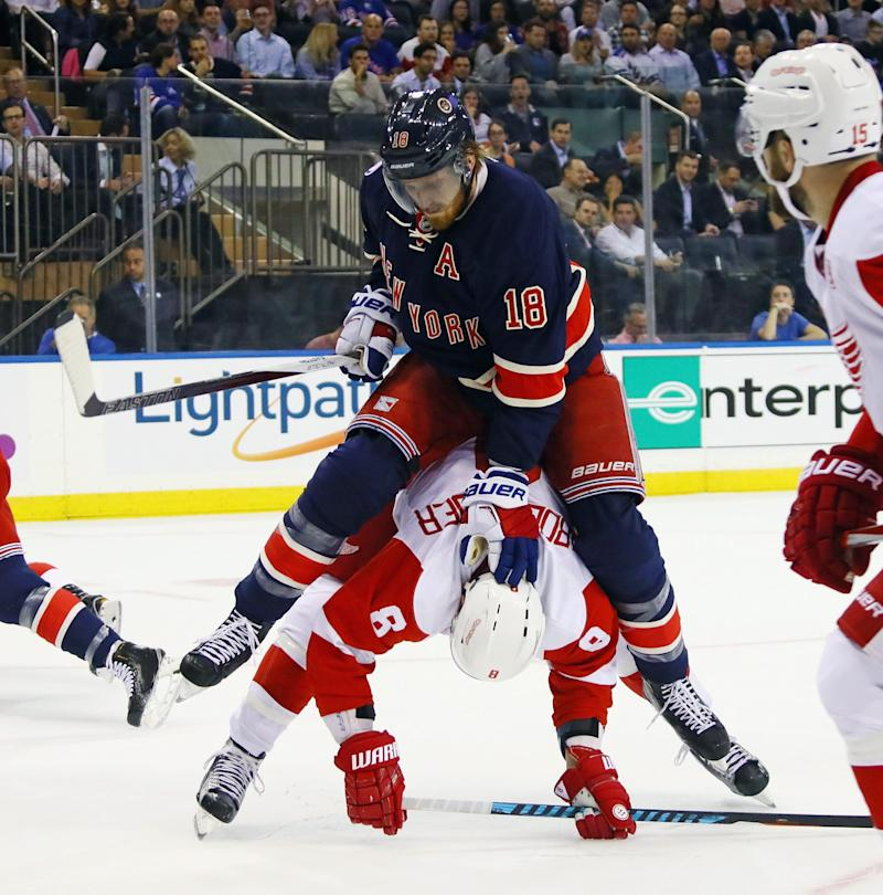 Marc Staal of the New York Rangers holds down Justin Abdelkader of the Detroit Red Wings during the first period at Madison Square Garden on Oct. 19, 2016 in New York City.