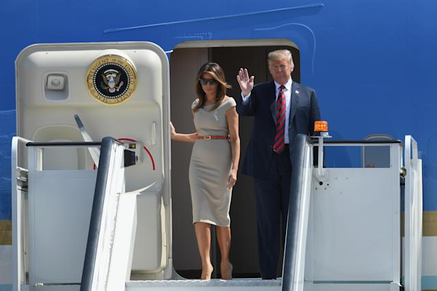 <p>Stepping off the plane in England for the Trumps' tour of the UK, Melania played it safe in a form-fitting midi dress by Roland Mouret. <em>[Photo: Getty]</em> </p>