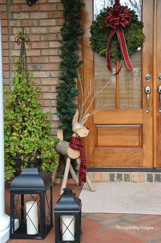 """<p>Whether it's a reindeer, snowman, or Santa, Christmastime characters add personality and liveliness to a porch display. Sure, it's a great look when there are kids in the house — but revelers of all ages light up when they see a familiar face like Rudolph's!<br></p><p><strong><em>Get the look at <a href=""""https://www.housepitalitydesigns.com/2015/12/14/christmas-2015-front-porch-with-rudy/"""" rel=""""nofollow noopener"""" target=""""_blank"""" data-ylk=""""slk:Hospitality Designs"""" class=""""link rapid-noclick-resp"""">Hospitality Designs</a>.</em></strong></p>"""