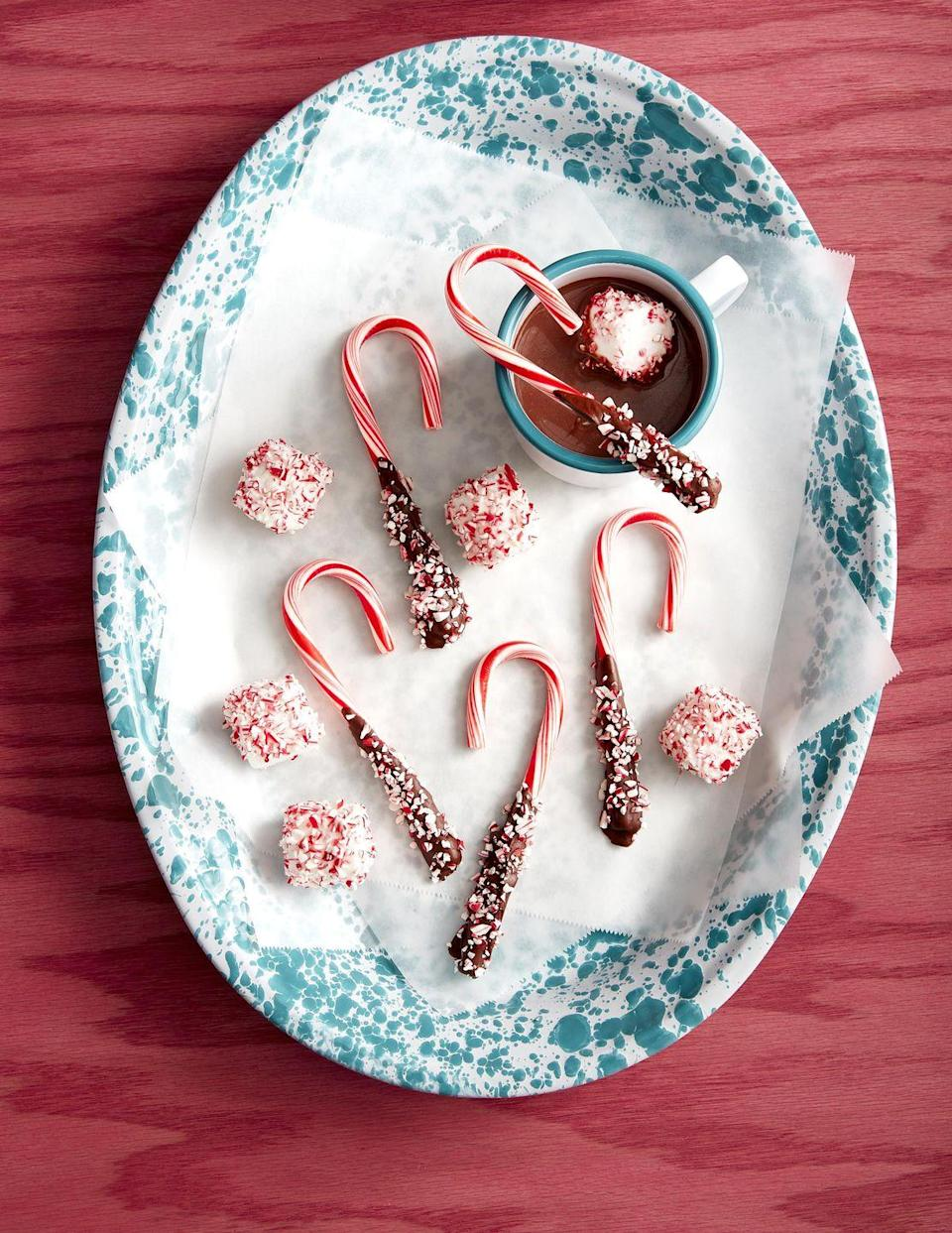 <p>Simple and tasty, these easy DIY peppermint Hot Chocolate Stirrers will get you through plenty of chilly days.</p><p><strong>To make</strong>: Dip ends of candy cane in melted semisweet chocolate. Sprinkle with crushed candy canes: place on a parchment paper-lined plate, and chill. Lightly mist large marshmallows with water. Sprinkle with crushed candy canes.</p>