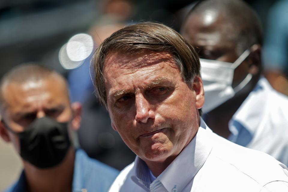 Brazilian President Jair Bolsonaro gestures as he speaks to the press after voting during the second round of municipal elections at the Rosa da Fonseca Municipal School, in the Military Village, Rio de Janeiro, Brazil, on November 29, 2020. - Brazilians go to the polls Sunday to chose mayors in 57 cities, including Sao Paulo and Rio de Janeiro, the most rich and populated, in a runoff marked by the economic crisis and an upsurge of the new coronavirus. (Photo by Andre Coelho / AFP) (Photo by ANDRE COELHO/AFP via Getty Images)