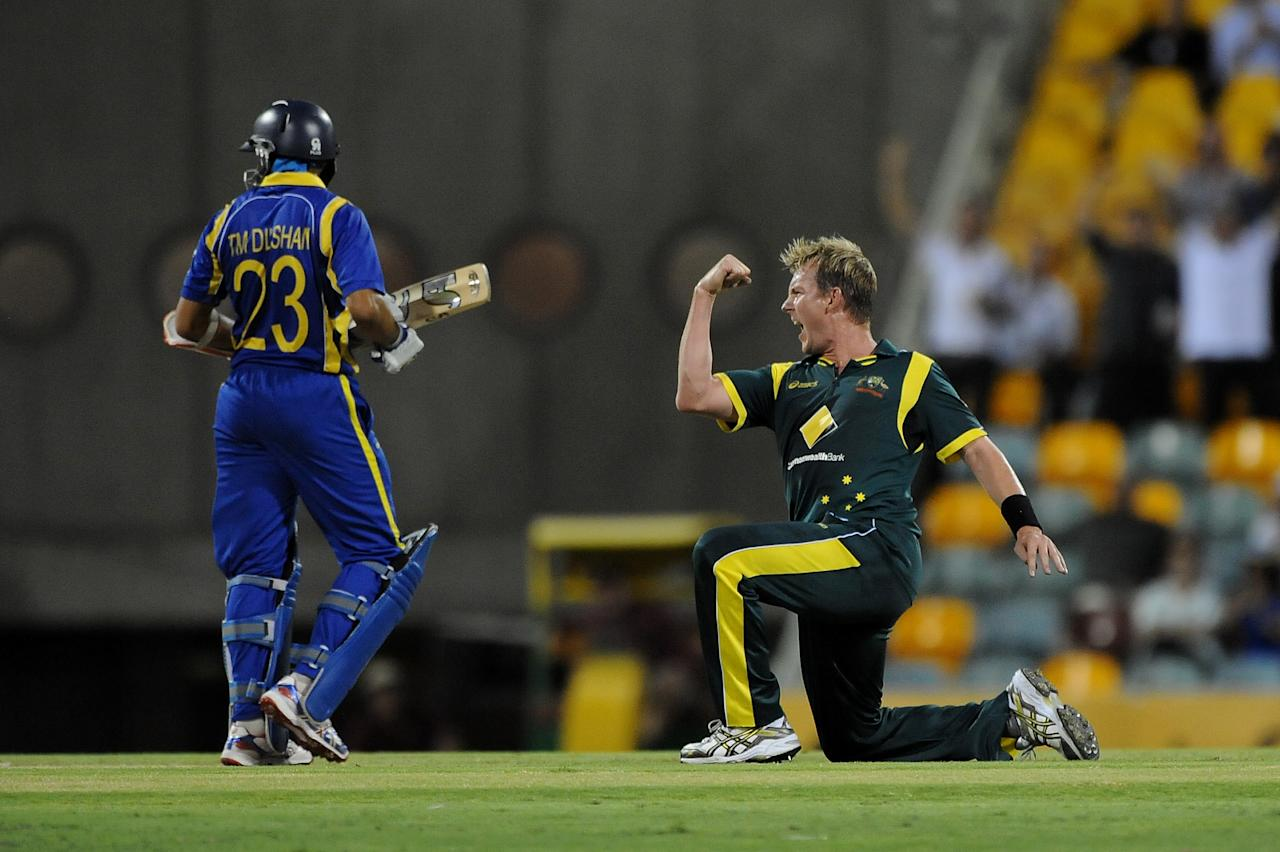 Brett Lee of Australia celebrates taking the wicket of Tillakaratne of Sri Lanka during the first One Day International final match between Australia and Sri Lanka at The Gabba on March 4, 2012 in Brisbane, Australia.