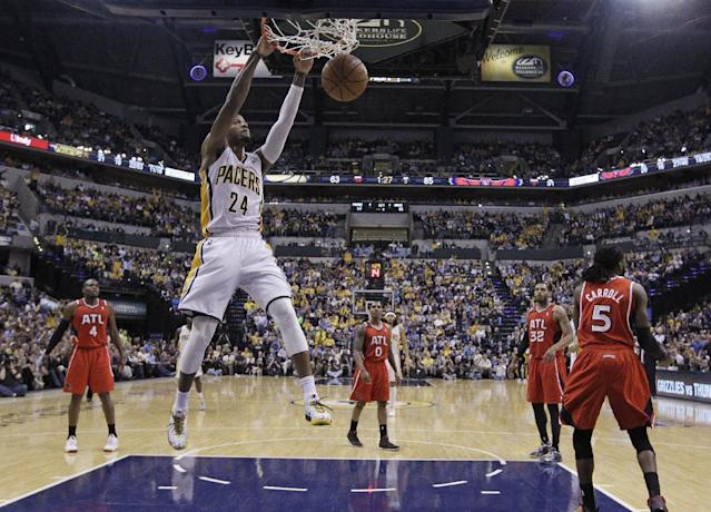 Indiana Pacers' Paul George (24) dunks during the second half in Game 5 of an opening-round NBA basketball playoff series against the Atlanta Hawks Monday, April 28, 2014, in Indianapolis. Atlanta defeated Indiana 107-97. (AP Photo/Darron Cummings)