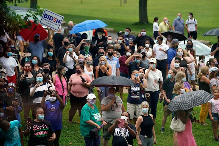 People stand outside before Democratic presidential candidate former Vice President Joe Biden and his running mate Sen. Kamala Harris (D-Calif.) appear at Alexis Dupont High School in Wilmington on Aug. 12. (Photo: AP Photo/Carolyn Kaster)
