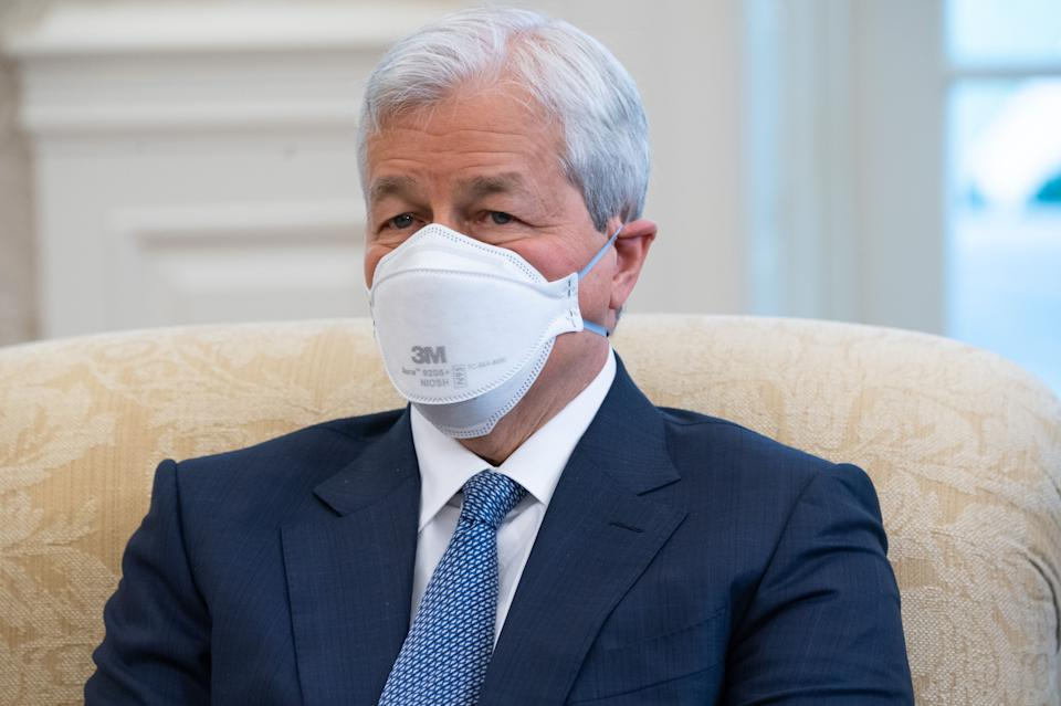 Jamie Dimon, Chairman and CEO of JPMorgan Chase, attends a meeting hosted by US President Joe Biden with business leaders about a Covid-19 relief bill in the Oval Office of the White House in Washington, DC, February 9, 2021. (Photo by SAUL LOEB / AFP) (Photo by SAUL LOEB/AFP via Getty Images)