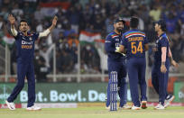 India's Shardul Thakur, second right celebrates the wicket of England's captain Eoin Morgan during the second Twenty20 cricket match between India and England at Narendra Modi Stadium in Ahmedabad, India, Sunday, March 14, 2021. (AP Photo/Aijaz Rahi)