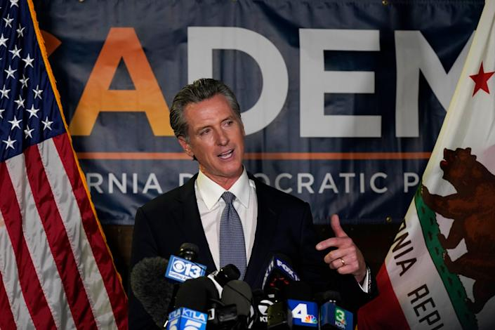 California Gov. Gavin Newsom addresses reporters after beating back the recall that aimed to remove him from office at the John L. Burton California Democratic Party headquarters in Sacramento, Calif., Tuesday, Sept. 14, 2021. (AP Photo/Rich Pedroncelli)