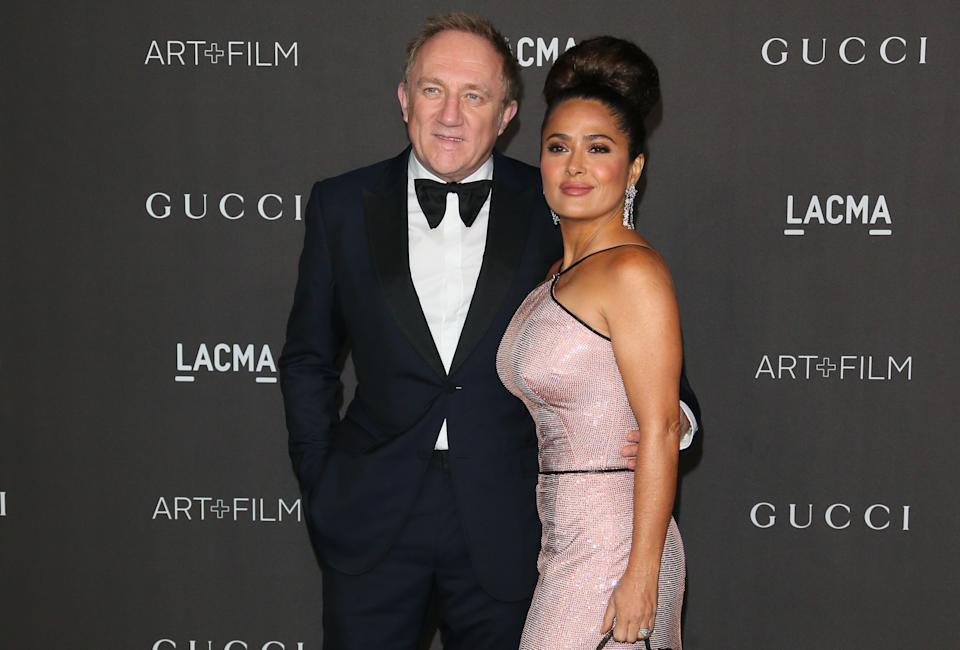 US-Mexican actress Salma Hayek (R) and husband French businessman Francois-Henri Pinault arrive for the 2019 LACMA Art+Film Gala at the Los Angeles County Museum of Art in Los Angeles on November 2, 2019. (Photo by Jean-Baptiste LACROIX / AFP) (Photo by JEAN-BAPTISTE LACROIX/AFP via Getty Images)