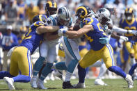 Los Angeles Rams outside linebacker Clay Matthews (52) and linebacker Bryce Hager (54) tackle Carolina Panthers running back Christian McCaffrey (22) during the first half an NFL football game in Charlotte, N.C., Sunday, Sept. 8, 2019. (AP Photo/Mike McCarn)