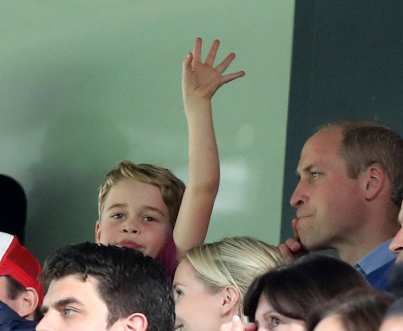 Prince George waving at Carrow Road as he watches with his father Prince William during the Premier League match between Norwich City and Aston Villa at Carrow Road on October 5, 2019 in Norwich, United Kingdom.