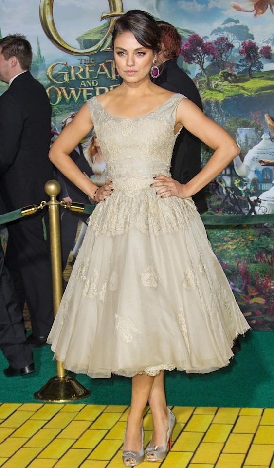 "Kunis is sexy even in a prim and proper dress like the lacy Dolce & Gabbana creation that she wore for the ""Oz the Great and Powerful"" premiere in Hollywood. (2/13/2013)"