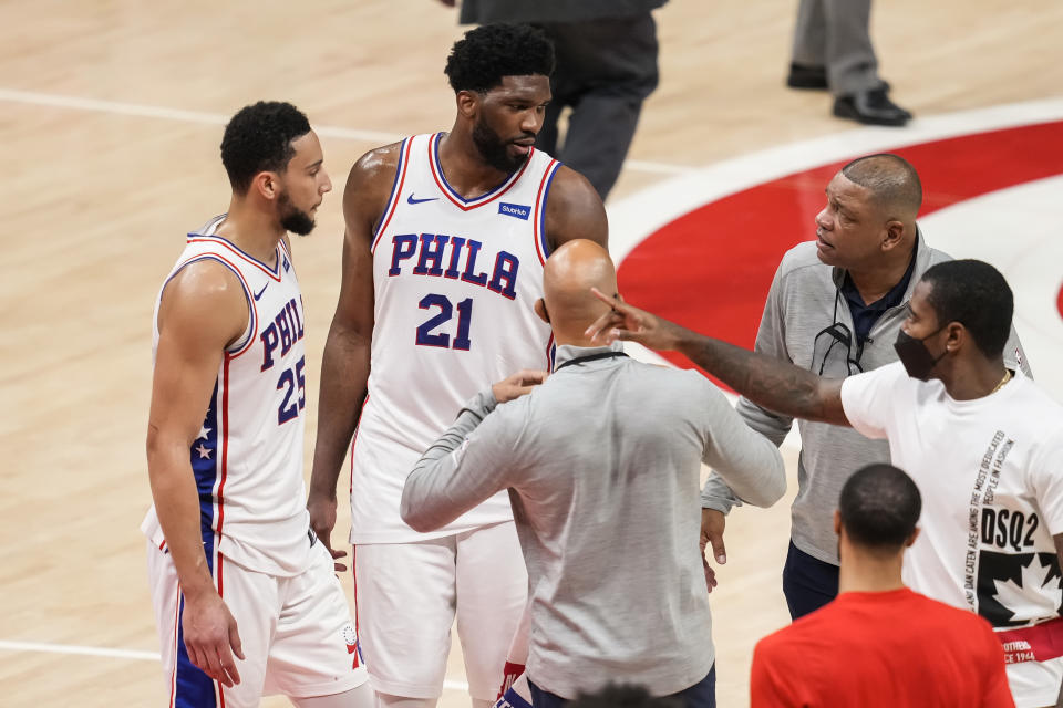 Jun 11, 2021; Atlanta, Georgia, USA; Philadelphia 76ers center Joel Embiid (21) and guard Ben Simmons (25) react with head coach Doc Rivers (right) after the 76ers defeated the Atlanta Hawks in game three in the second round of the 2021 NBA Playoffs at State Farm Arena. Mandatory Credit: Dale Zanine-USA TODAY Sports