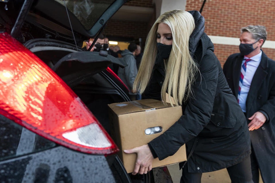Ivanka Trump, daughter of and advisor to President Donald Trump, loads a box of fresh meat, produce and dairy in a car during a food distribution to the local community in Woodbridge, Va., Monday, Dec. 14, 2020. (AP Photo/Manuel Balce Ceneta)