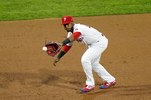 Philadelphia Phillies third baseman Jean Segura fields a ground out by Atlanta Braves' Nick Markakis during the sixth inning of a baseball game, Sunday, Aug. 30, 2020, in Philadelphia. (AP Photo/Matt Slocum)