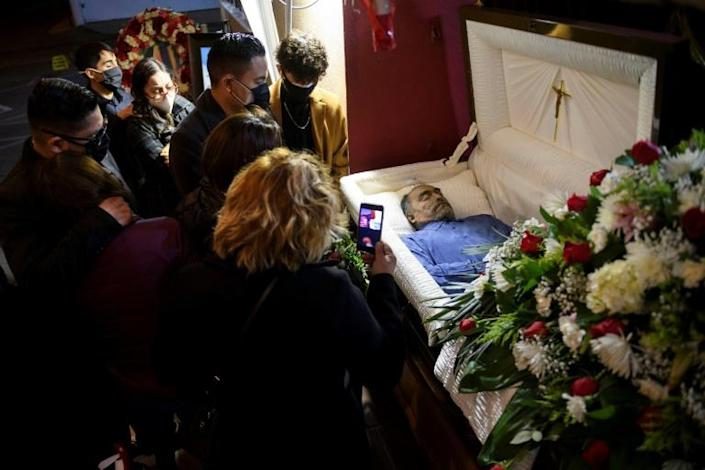 The United Staes has by far the highest number of coronavirus cases and deaths in the world -- here, the family of Gilberto Arreguin Camacho, 58, mourns in California