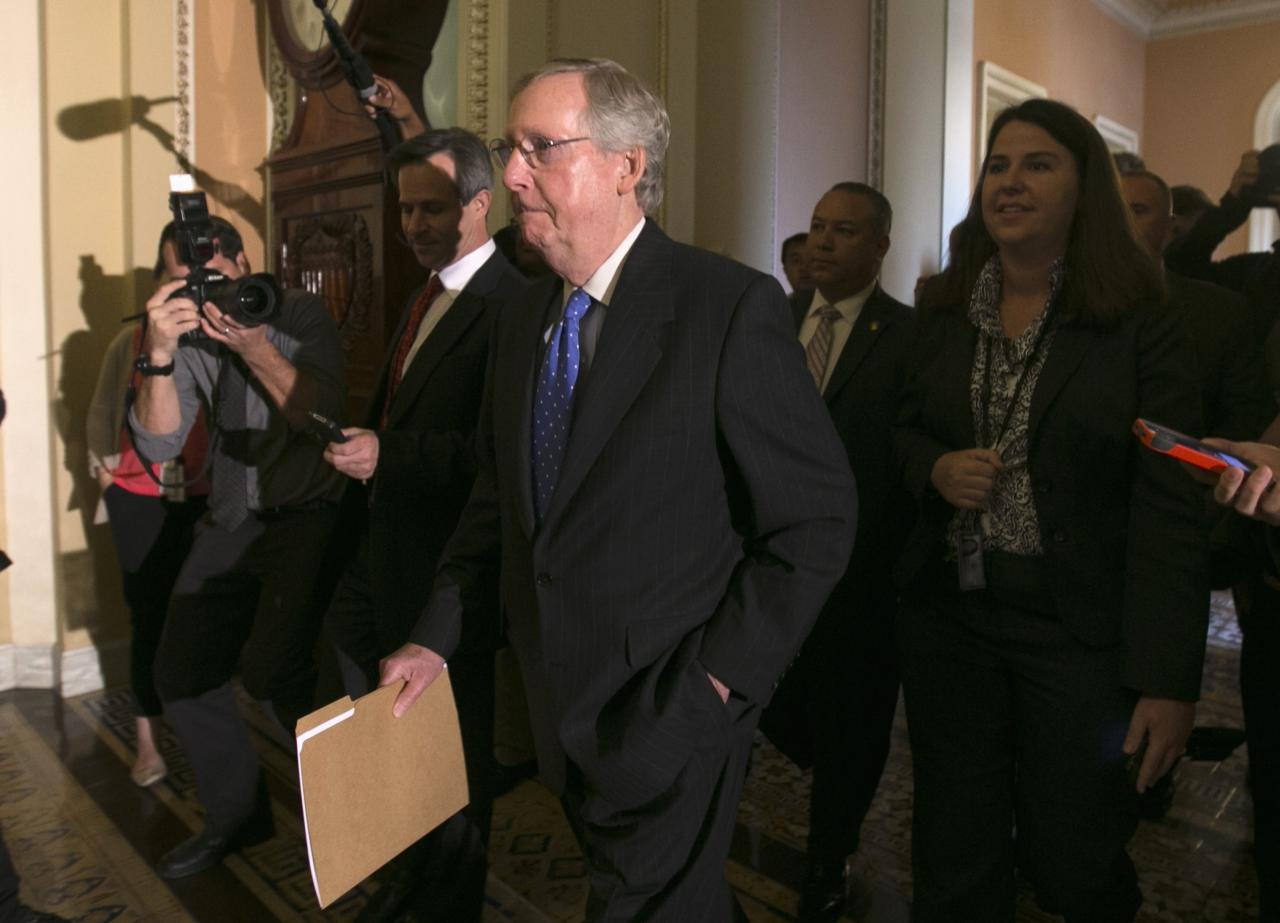 Senate Minority leader Mitch McConnell is trailed by reporters as he walks to the Senate Chamber in the U.S. Capitol in Washington October 16, 2013. The U.S. Senate announced a last-minute deal on Wednesday to avert a historic lapse in the government's borrowing ability and a potentially damaging debt default, and to reopen the government after a two-week shutdown. But even if the Senate and House of Representatives manage to overcome procedural hurdles to seal the deal before Thursday - when the Treasury says it will exhaust its borrowing authority - it will only be a temporary solution that sets up the prospect of another showdown early next year. 