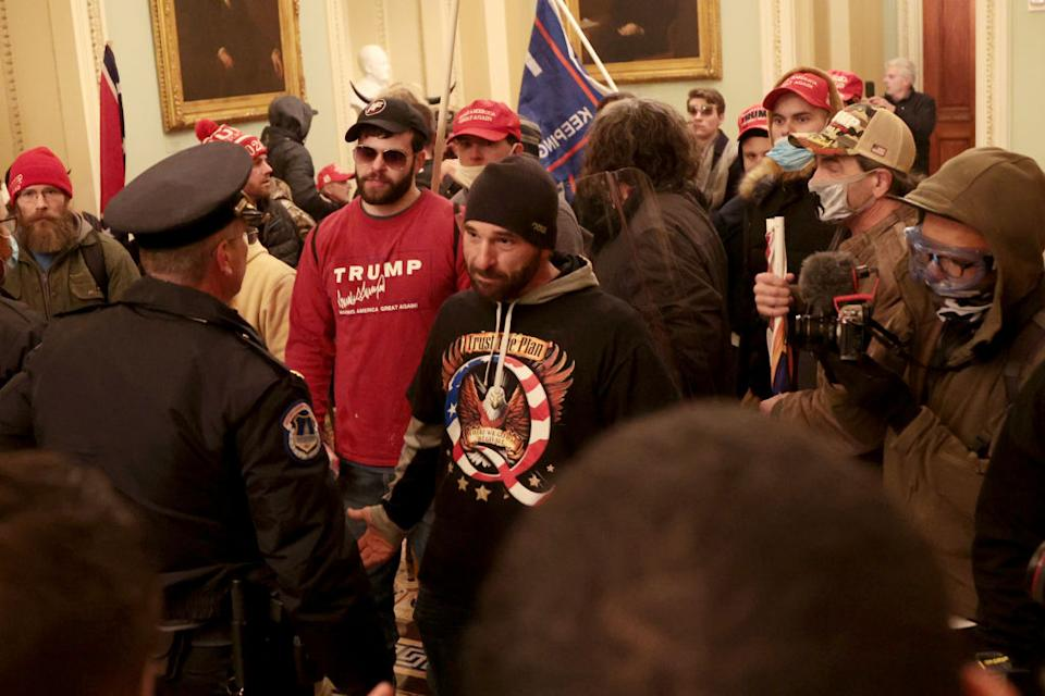 Protesters interact with Capitol Police inside the US Capitol Building. Source: Getty