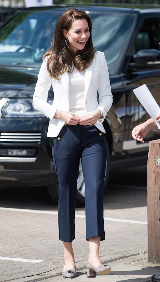 <p>In J. Crew kick flare pants, a Zara white blazer, matching t-shirt and a neutral wedge while attending the 1851 Trust Roadshow at Docklands Sailing and Watersports Centre. </p>