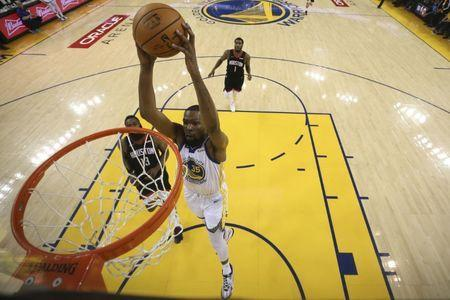 FILE PHOTO: May 8, 2019; Oakland, CA, USA; Golden State Warriors forward Kevin Durant (35) dunks the basketball against the Houston Rockets during the first half in game five of the second round of the 2019 NBA Playoffs at Oracle Arena. Mandatory Credit: Ezra Shaw/Pool Photo via USA TODAY Sports