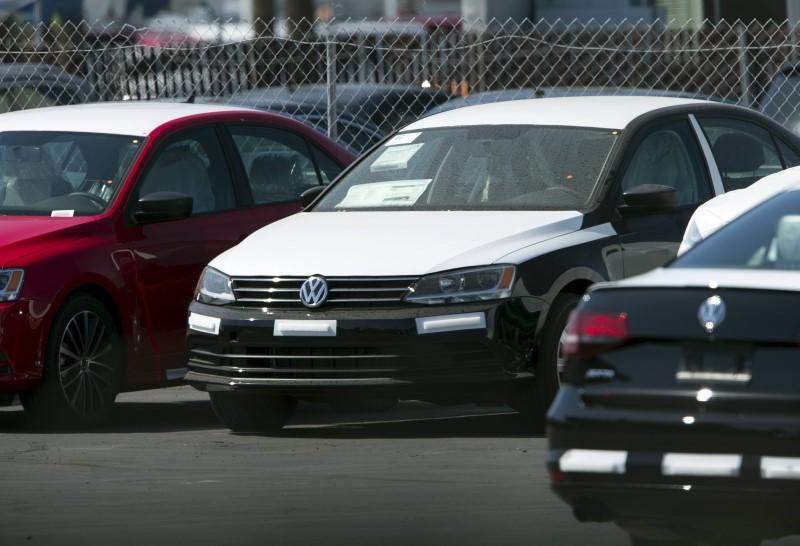 Newly shipped Volkswagen vehicles sit on a back lot at a Volkswagen dealership in San Diego, California