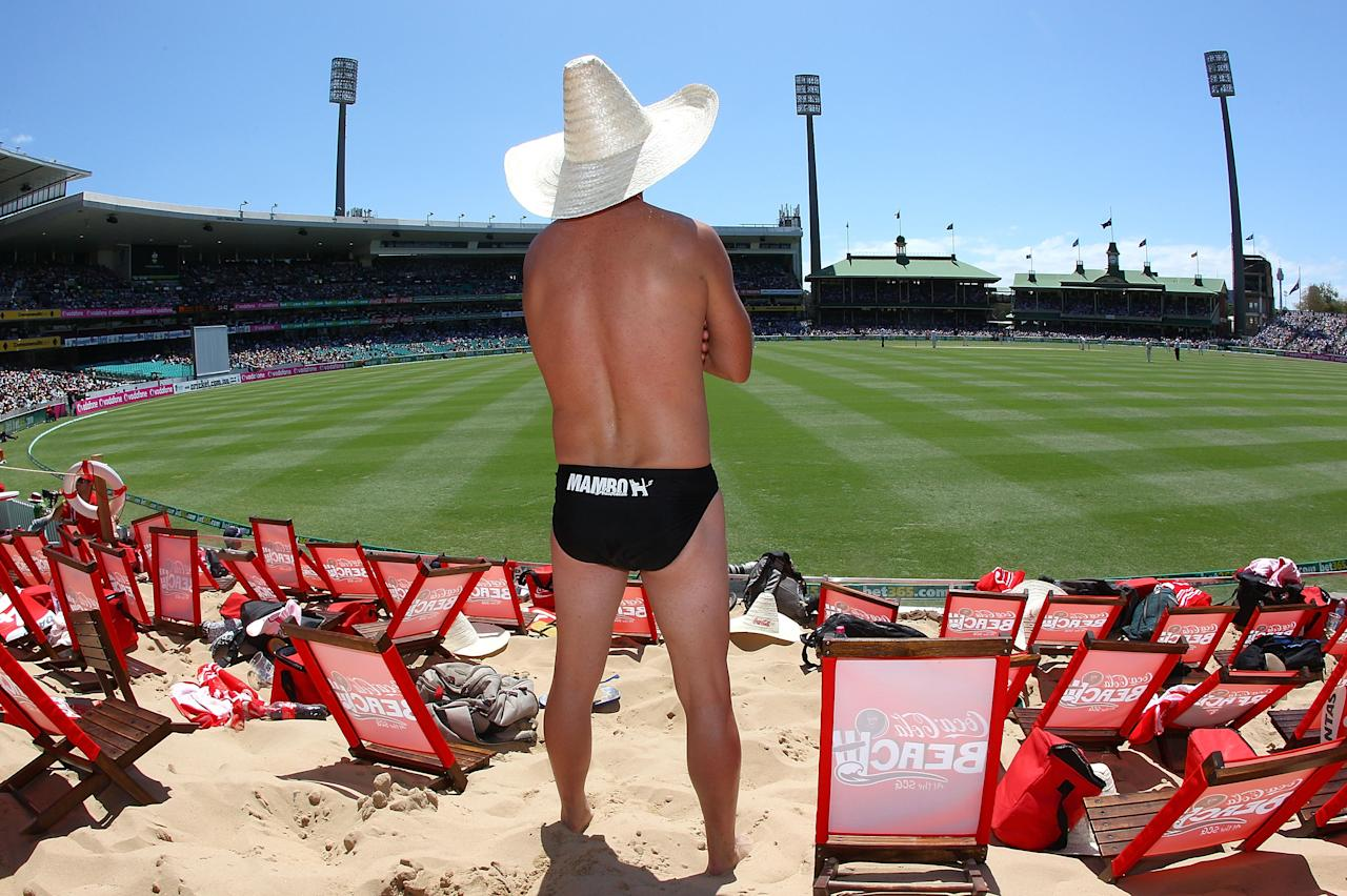 SYDNEY, AUSTRALIA - JANUARY 03:  A fan soaks up the sun at the Coca-Cola Beach during day one of the Third Test match between Australia and Sri Lanka at Sydney Cricket Ground on January 3, 2013 in Sydney, Australia.  (Photo by Marianna Massey/Getty Images)