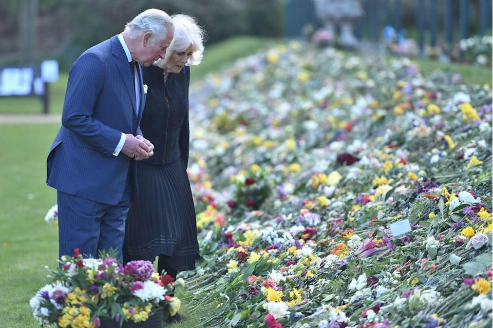 <p>Shortly after Prince Philip's death, Prince Charles and Camilla visited the gardens of Marlborough House to view the flowers and messages left by members of the public in his honor. </p>