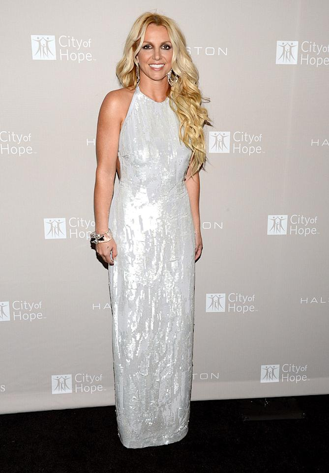 "It's a relief knowing that Britney Spears can still clean up well. We tend to see the mom-of-two running errands in ripped Daisy Dukes and Uggs, but, at this year's City of Hope celebration, the overpaid ""X Factor"" judge impressed in a sequined Halston gown and abundance of hair extensions. (10/10/2012)"