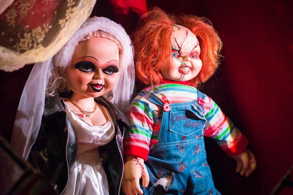 The Bride of Chucky and Chucky, two horror doll characters.