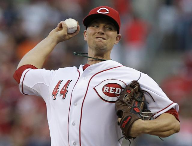 Cincinnati Reds starting pitcher Mike Leake throws against the St. Louis Cardinals in the first inning of a baseball game, Sunday, May 25, 2014, in Cincinnati. (AP Photo/Al Behrman)