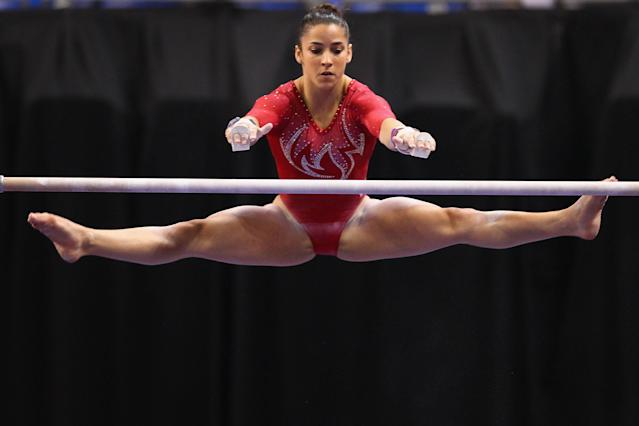 ST. LOUIS, MO - JUNE 8: Alexandra Raisman competes on the uneven bars during the Senior Women's competition on day two of the Visa Championships at Chaifetz Arena on June 8, 2012 in St. Louis, Missouri. (Photo by Dilip Vishwanat/Getty Images)