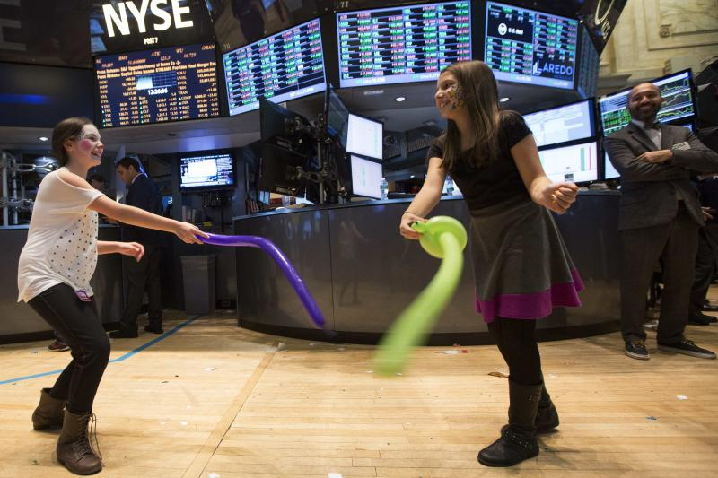 Children play during the trading day on the floor of the New York Stock Exchange