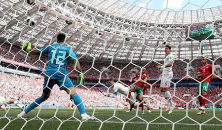 Soccer Football - World Cup - Group B - Portugal vs Morocco - Luzhniki Stadium, Moscow, Russia - June 20, 2018 Portugal's Cristiano Ronaldo scores their first goal REUTERS/Carl Recine