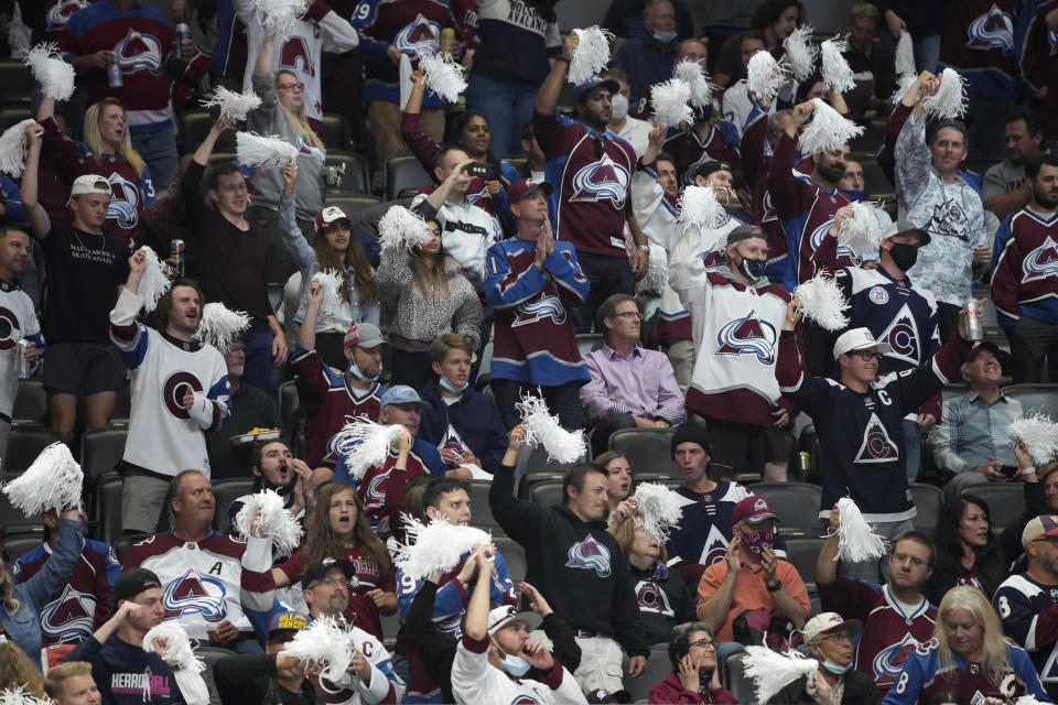 Fans cheer for the Colorado Avalanche in the third period of Game 5 of an NHL hockey Stanley Cup second-round playoff series against the Vegas Golden Knights on Tuesday, June 8, 2021, in Denver. (AP Photo/David Zalubowski)