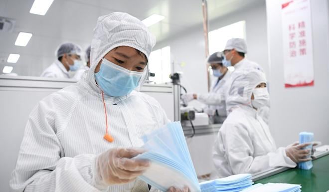China is the world's largest producer of face masks and protective gowns. Photo: Xinhua