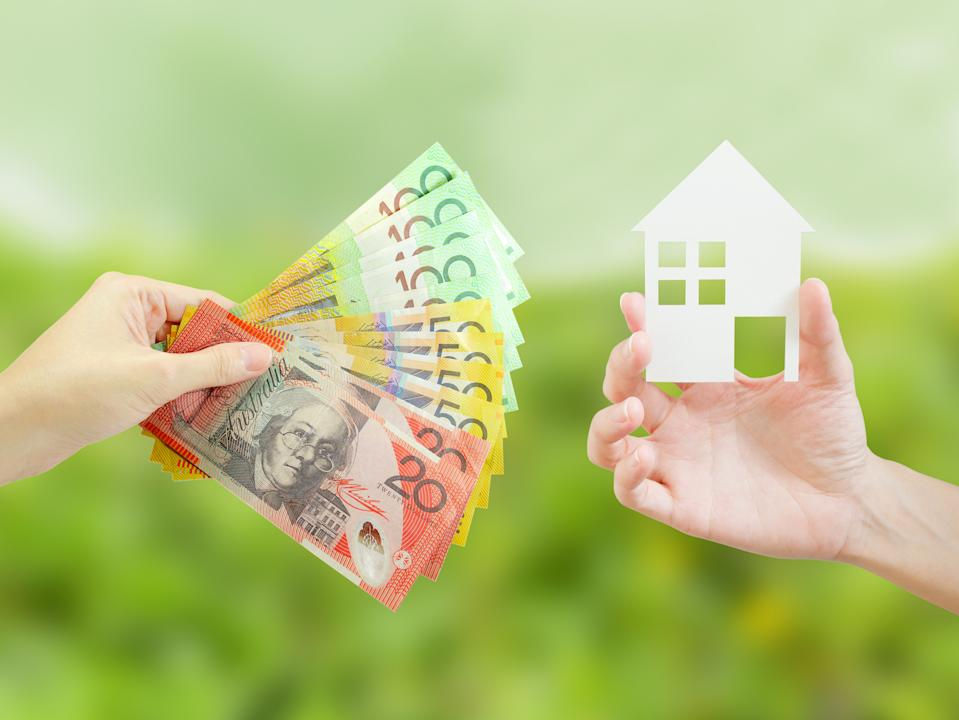 Client giving Australian money to property agent for buying house.