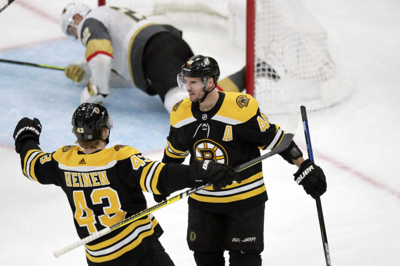 Boston Bruins center David Krejci (46) is congratulated by center Danton Heinen (43) after scoring on Vegas Golden Knights defenseman Nick Holden, in net, during the third period of an NHL hockey game in Boston, Tuesday, Jan. 21, 2020. (AP Photo/Charles Krupa)