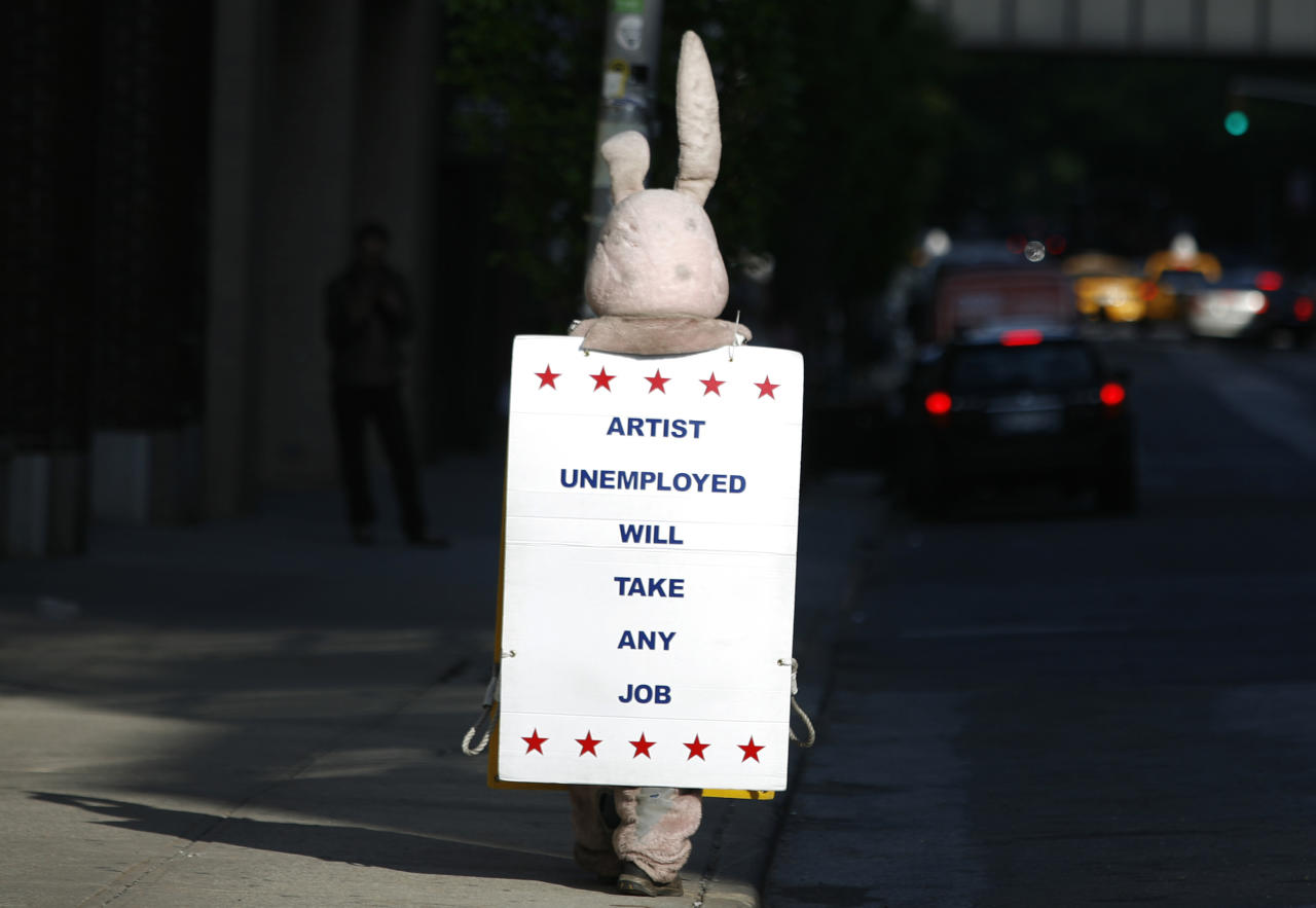 A person dressed as a bunny walks down the street with a sign in New York May 13, 2009.   REUTERS/Shannon Stapleton   (UNITED STATES SOCIETY IMAGES OF THE DAY)
