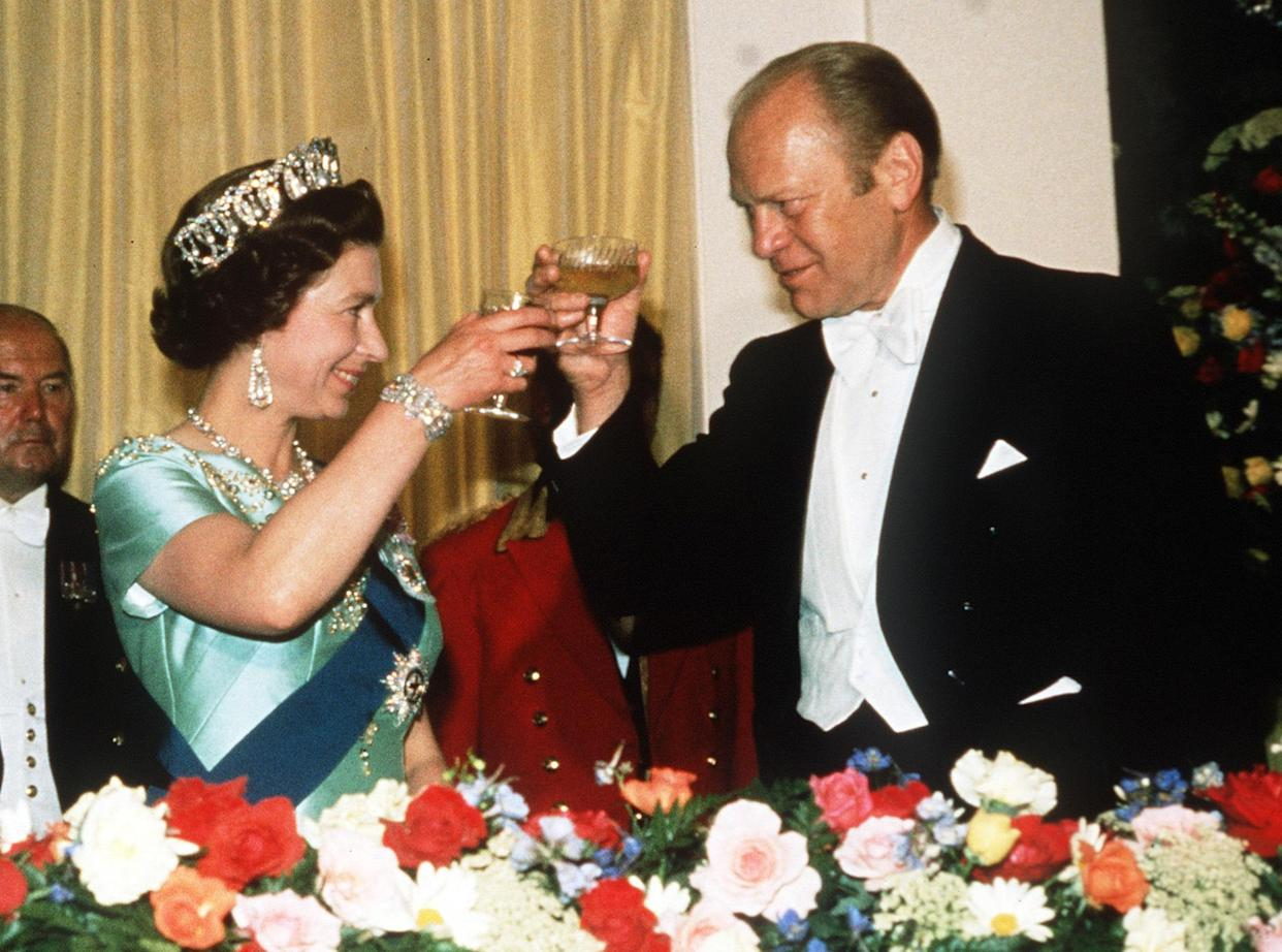 Queen Elizabeth ll toasts President Gerald Ford during a State Visit to the USA in July, 1976.  EMPICS Entertainment Photo.
