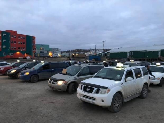 Caribou Cabs taxi drivers protested in Iqaluit Saturday evening. Drivers said rocks have been thrown at the cabs over the past three years and nothing is happening even after reporting it to RCMP. (Jordan Konek/CBC - image credit)