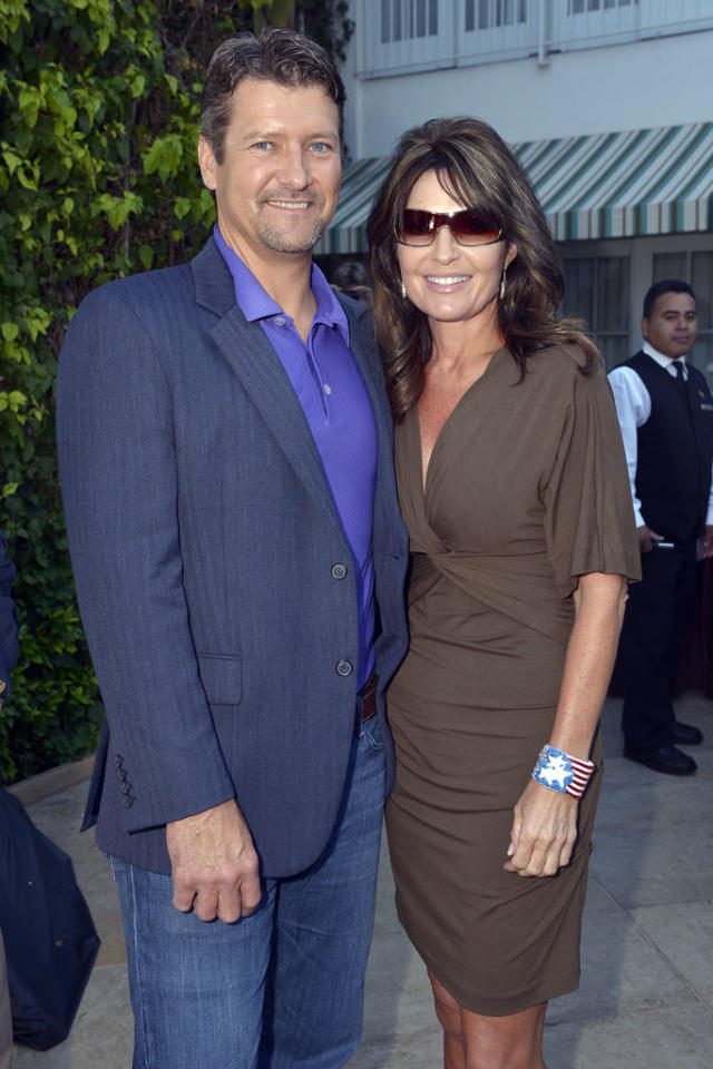 """Stars Earn Stripes"" cast member Todd Palin is joined by his wife, former Alaska Governor and Vice Presidential candidate Sarah Palin, at NBC's TCA Party, July 24, 2012."
