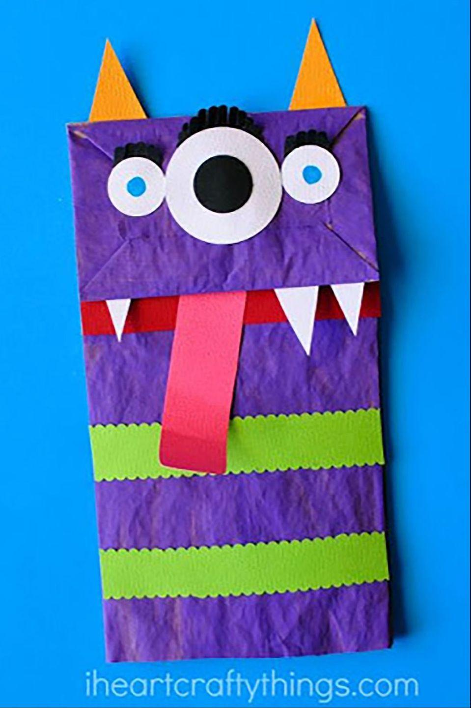 """<p>A perfect option for the youngest children in your family, these comical paper puppets will have them laughing for days. </p><p><strong>Get the tutorial at <a href=""""https://iheartcraftythings.com/paper-bag-monster-puppets.html"""" rel=""""nofollow noopener"""" target=""""_blank"""" data-ylk=""""slk:I Heart Crafty Things"""" class=""""link rapid-noclick-resp"""">I Heart Crafty Things</a>.</strong> </p>"""