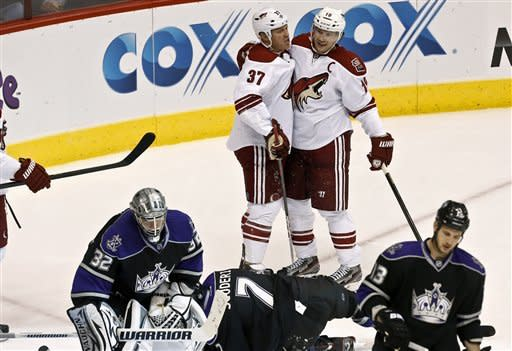Phoenix Coyotes' Raffi Torres (37) celebrates his goal against Los Angeles Kings' Jonathan Quick (32) with teammate Shane Doan (19) as Kings' Kyle Clifford, right, and Rob Scuderi (7) gather near Quick in the second period of an NHL hockey game Tuesday, March 12, 2013, in Glendale, Ariz. (AP Photo/Ross D. Franklin)