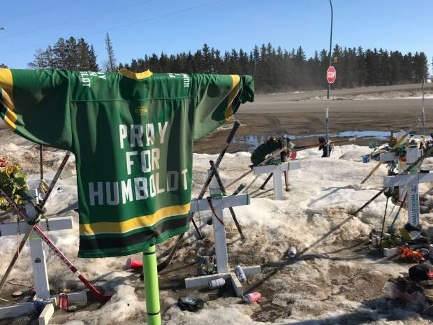 A 'pray for Humboldt' jersey is draped at the site of the Humboldt Broncos bus crash.