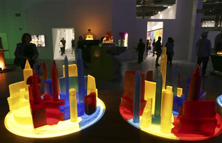 People view art pieces based on the bottle city of Kandor during an exhibition of work by late artist Mike Kelley during a media preview at The Geffen Contemporary at MOCA in Los Angeles